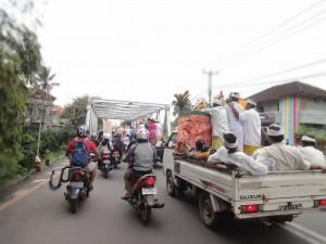 Riding to Ubud amongst a Hindu precession